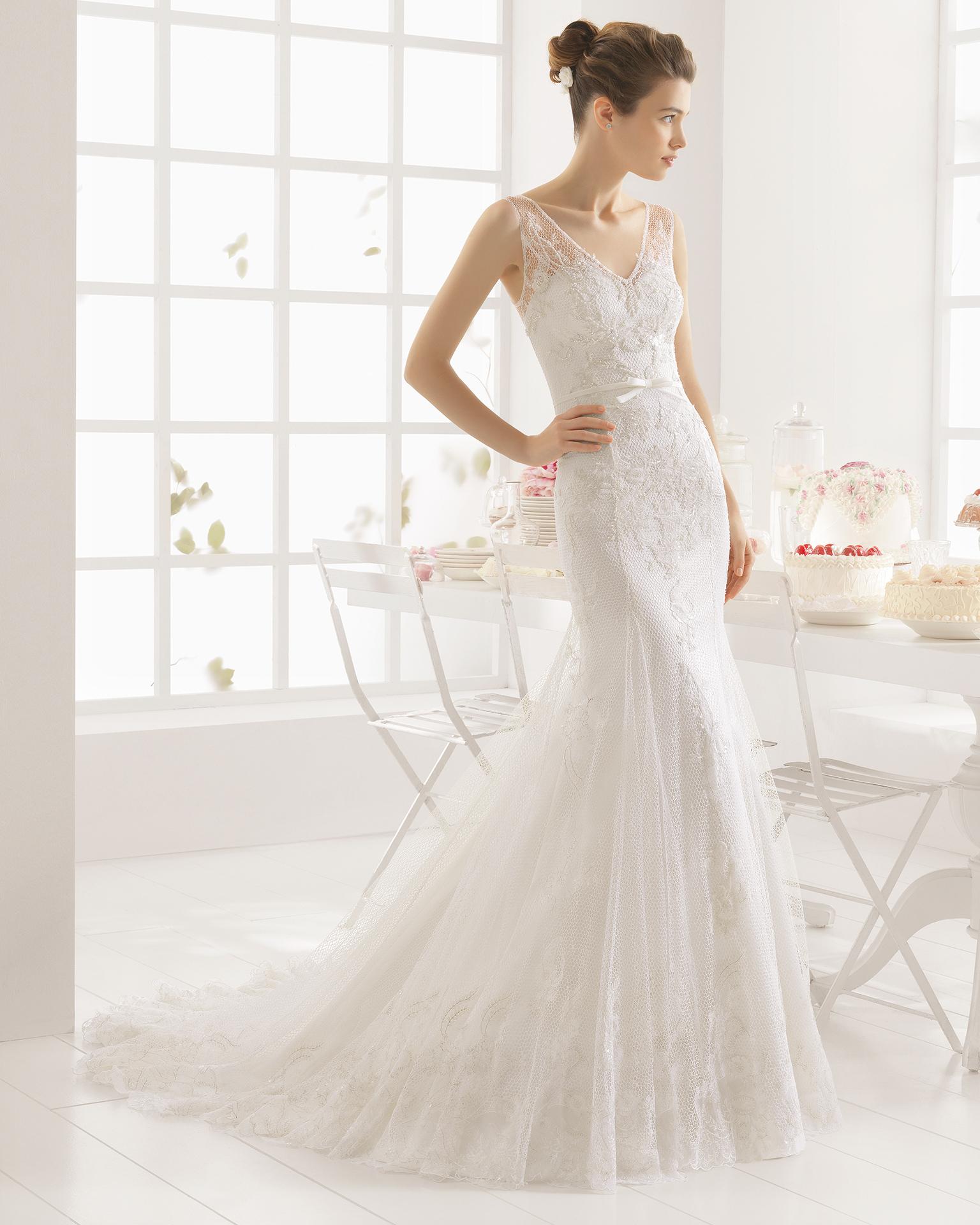 MAURO beaded lace and mesh wedding dress.