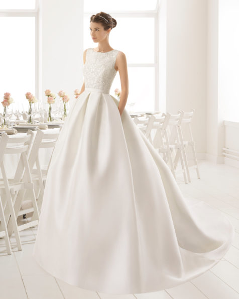 Classic-style tailored mikado wedding dress with beaded embroidery bodice, mikado skirt, bateau neckline and open back with bow details, in natural.