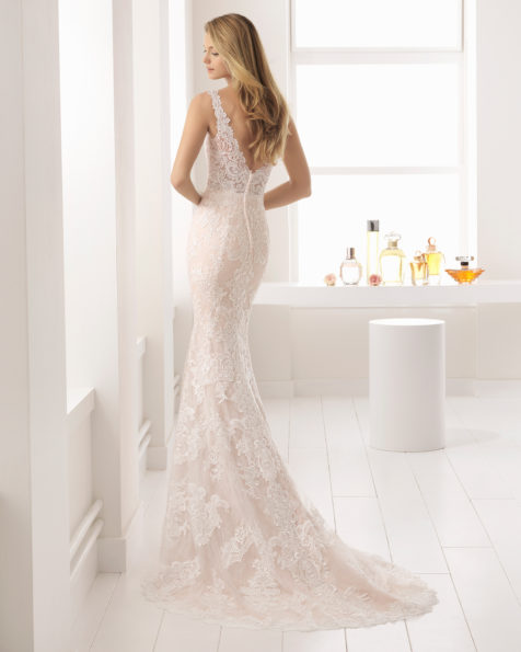 Romantic-style sheer lace wedding dress with V-neckline and low back, in rose and natural.