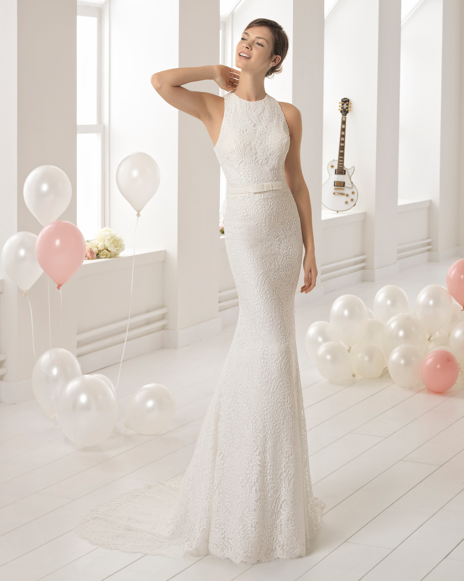 Beaded lace sheath wedding dress with halter neckline and crossover back.