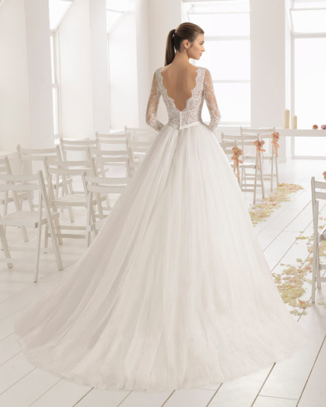 A-line lace and tulle wedding dress with long sleeves, bateau neckline and V-back.