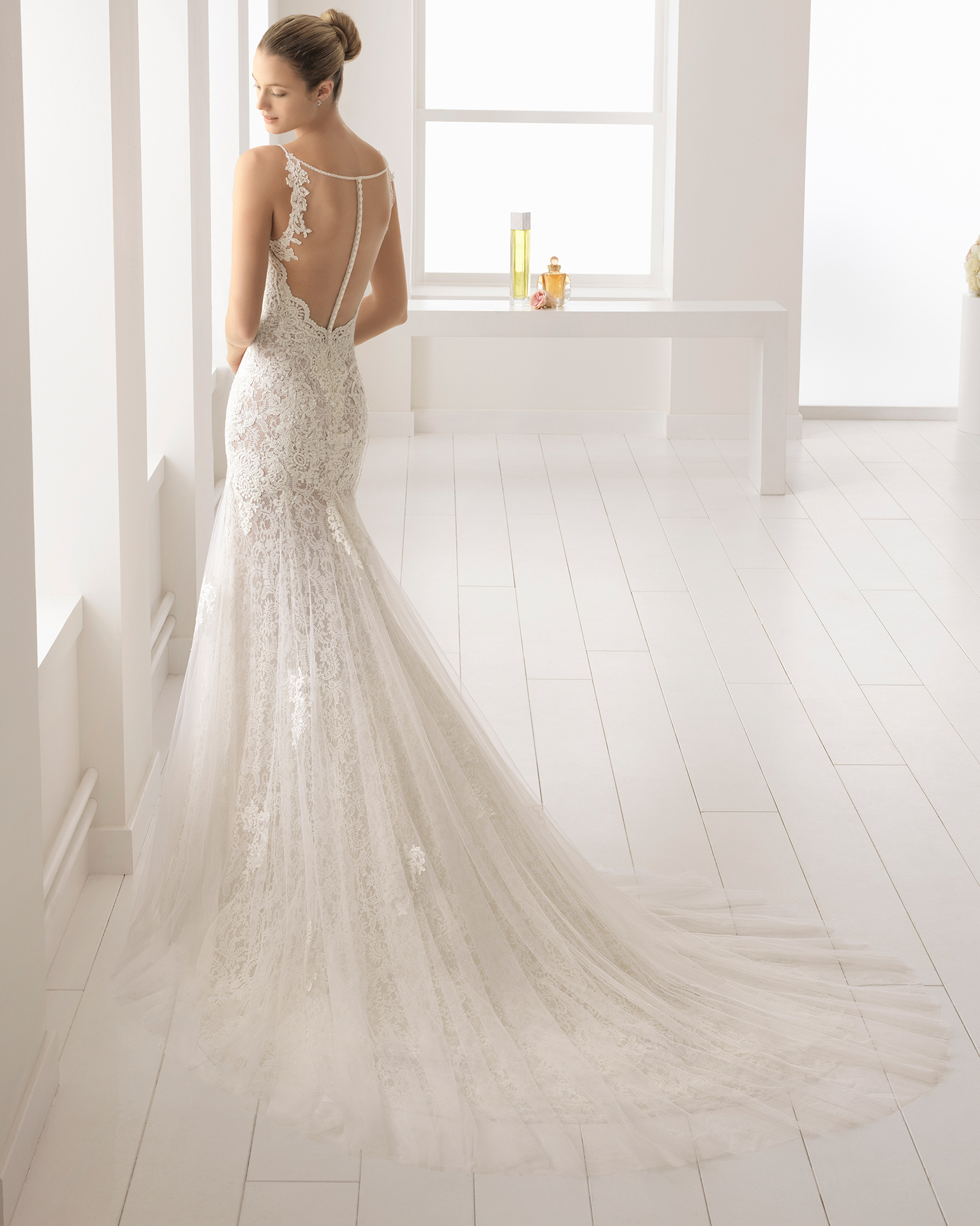 Mermaid-style beaded lace wedding dress with sheer inserts, sweetheart neckline and tattoo-effect back, in ivory.