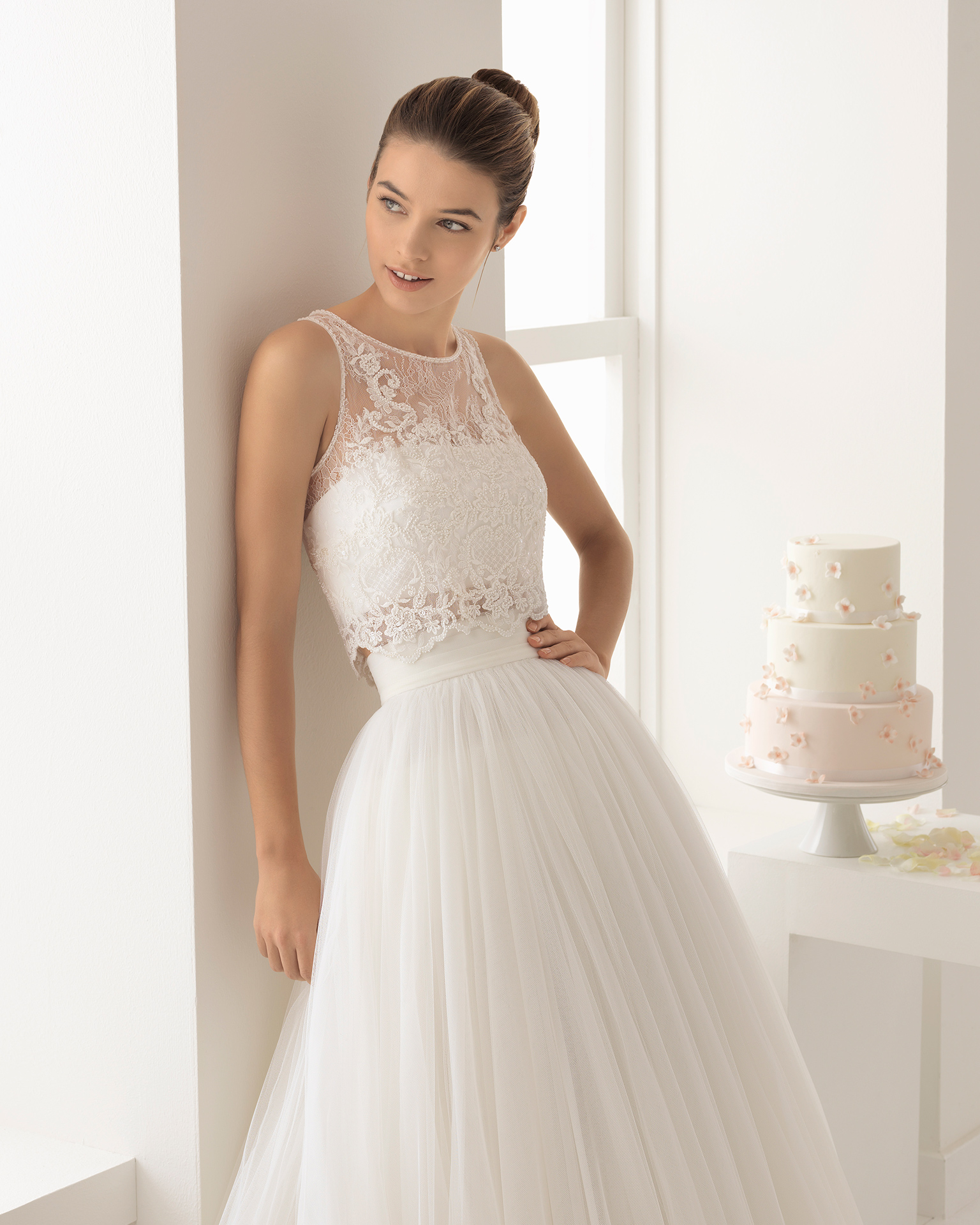 Boho-style tulle wedding dress with beaded lace crop top with front opening.