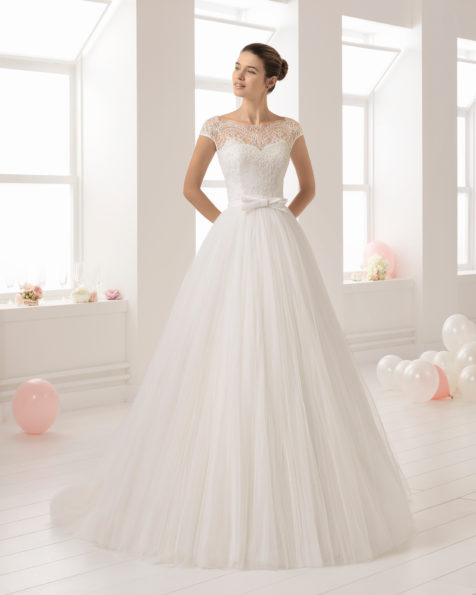 Romantic-style beaded lace and tulle wedding dress with illusion neckline and V-back.