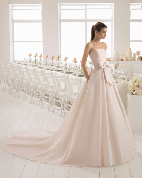 Romantic-style gazar strapless wedding dress, in rose, and in natural with bow at waist.