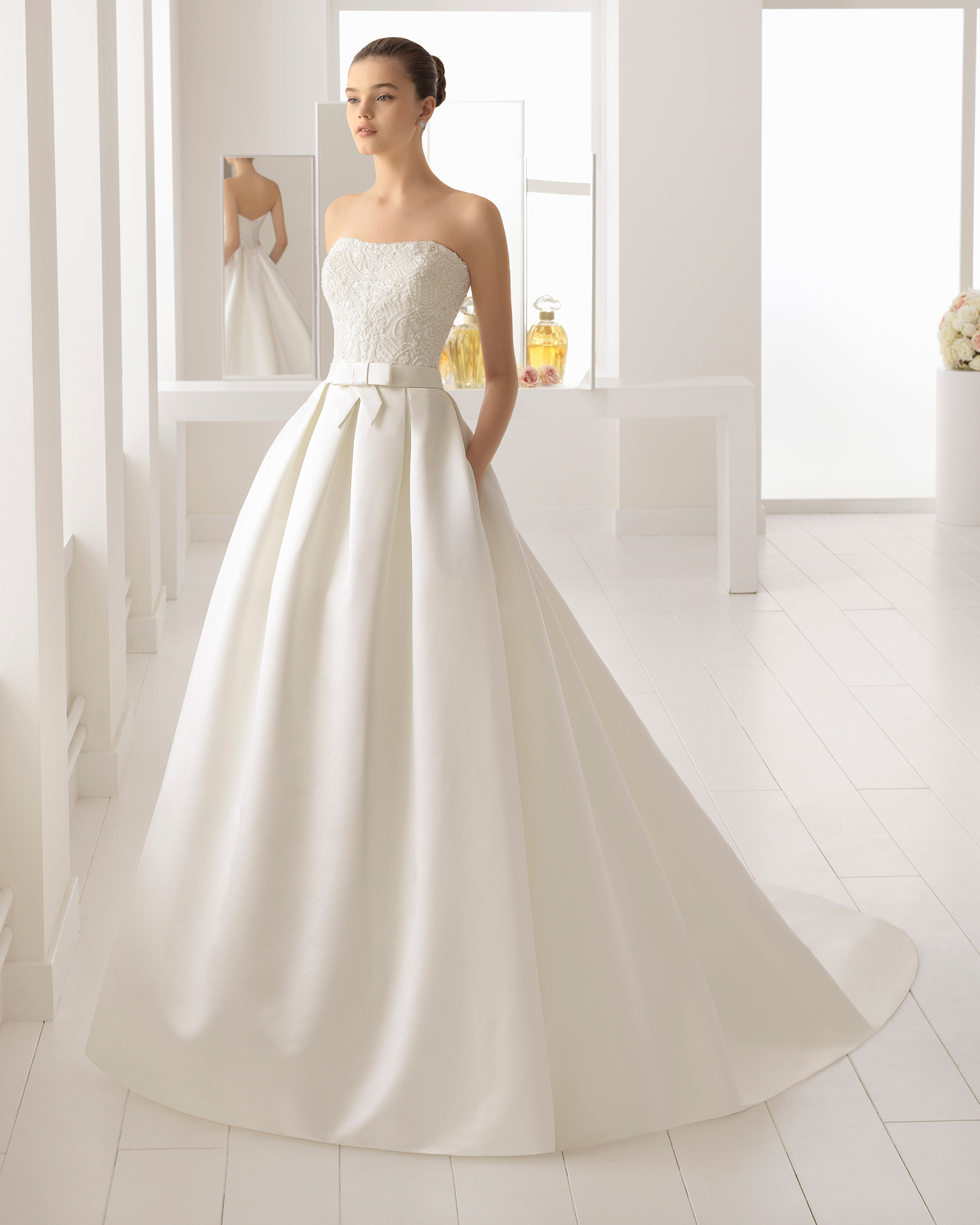 Classic-style beaded lace and duchess satin strapless wedding dress, in ivory.