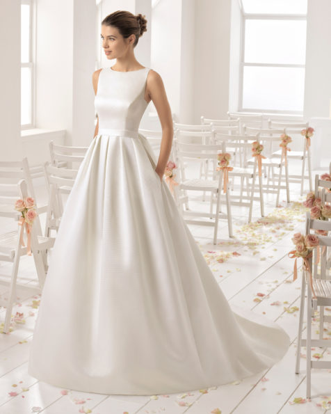 Classic-style ottoman wedding dress with bateau neckline and beaded lace back.