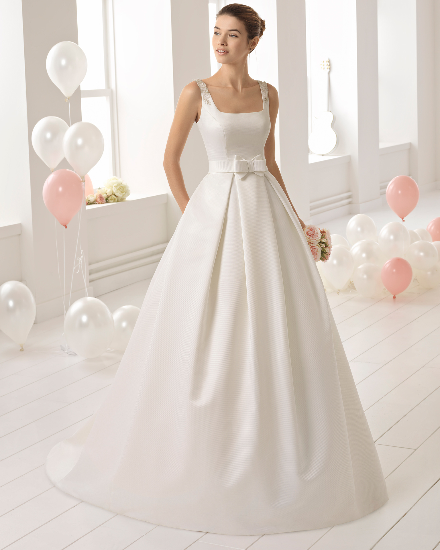 Classic-style beaded ottoman wedding dress with square neckline and pockets.