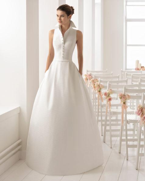 Klassisches Brautkleid aus Capri mit Hemdblusenkragen und Taschen.