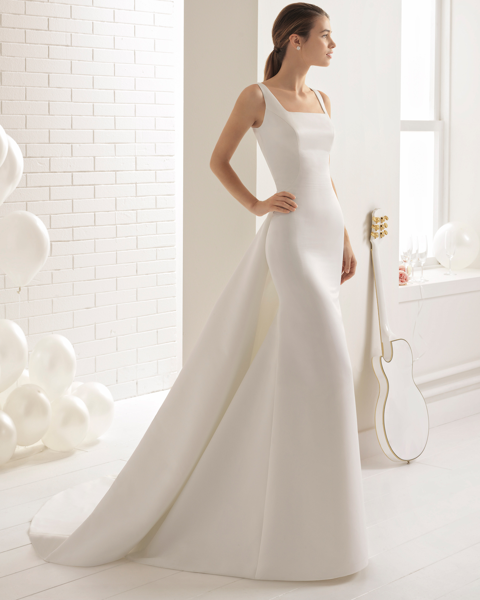 Ottoman sheath wedding dress with square neckline, round opening in back and train.