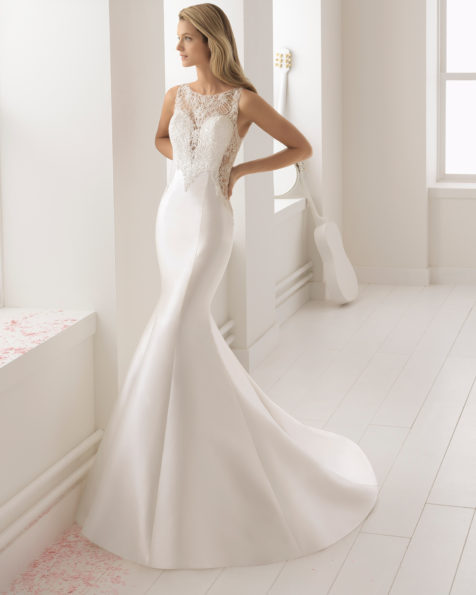 Mermaid-style beaded lace and mikado wedding dress with deep-plunge neckline.