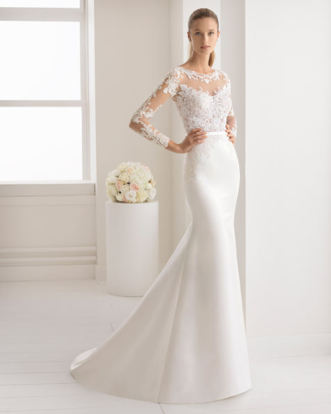 Mermaid-style beaded lace and duchess satin wedding dress with three-quarter sleeves and sheer inserts, in ivory.