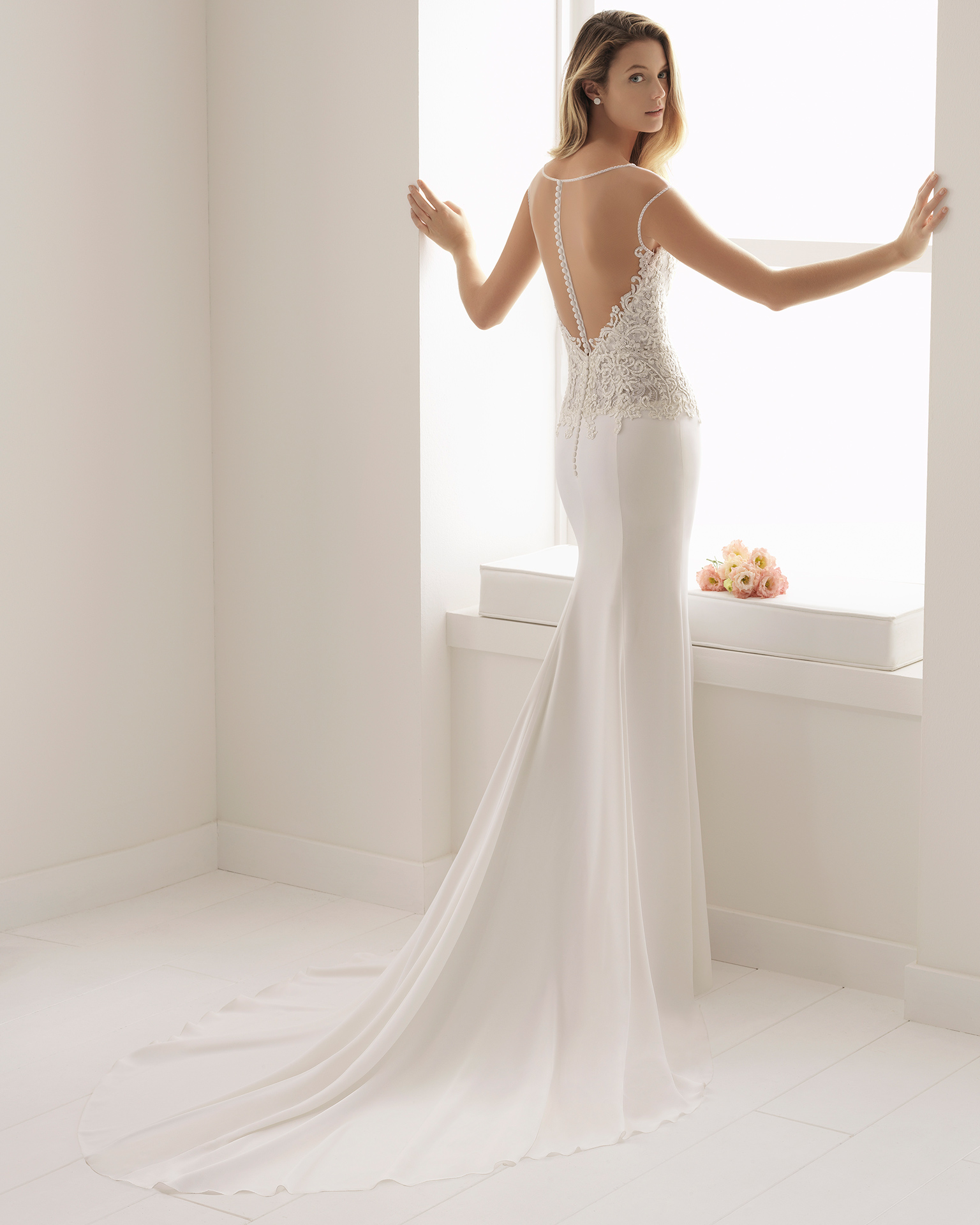 Mermaid-style beaded sheer lace and crepe wedding dress with illusion neckline and low back.
