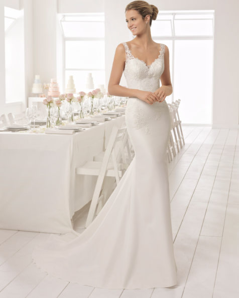 Classic-style beaded lace and crepe wedding dress with V-neckline and low back.