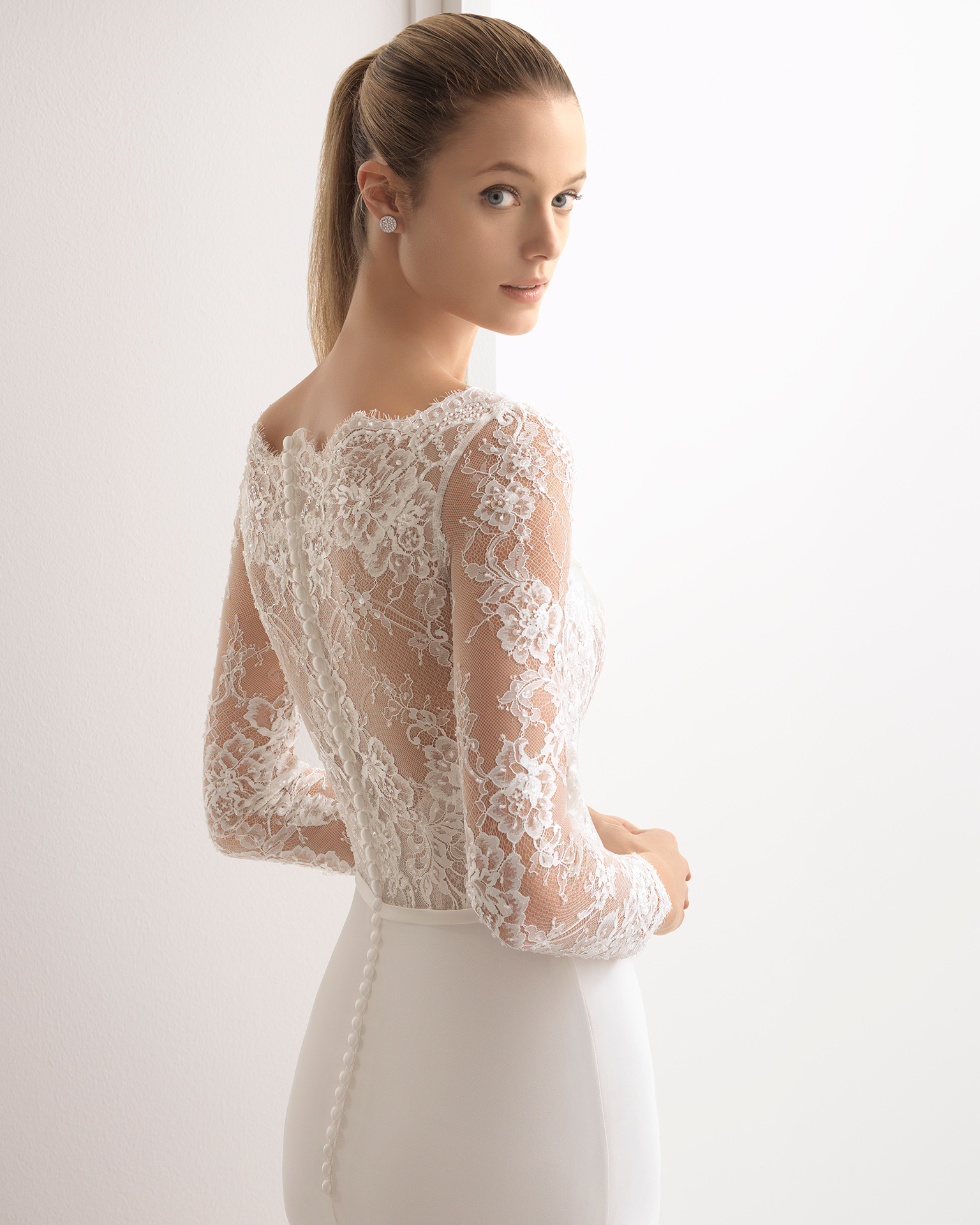 Classic-style beaded sheer lace and crepe Georgette wedding dress with long sleeves and bateau neckline.