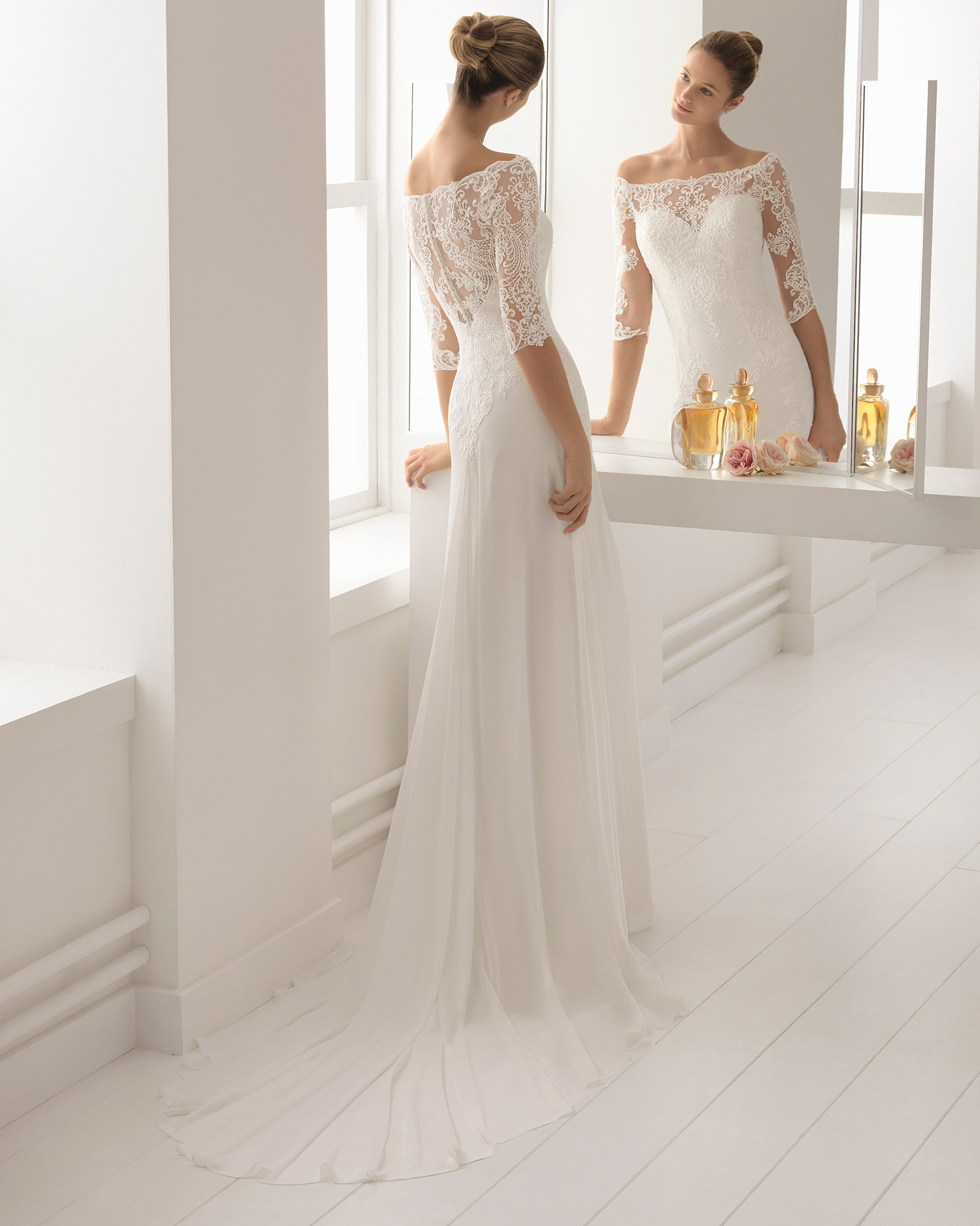 Classic-style beaded lace and chiffon wedding dress with three-quarter sleeves and sweetheart neckline.