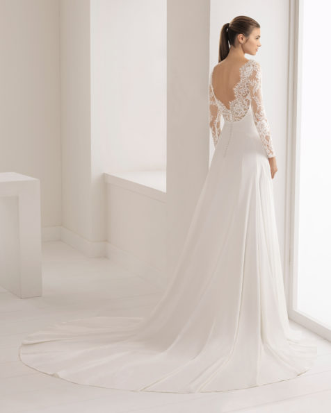 Classic-style crepe wedding dress with long sleeves and open beaded lace back.