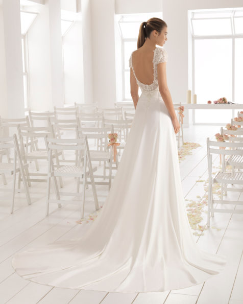 Classic-style crepe wedding dress with short sleeves and jeweled back with frosted beading.