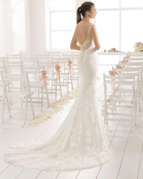 Mermaid-style lace wedding dress with sweetheart neckline and low back, in natural/nude.