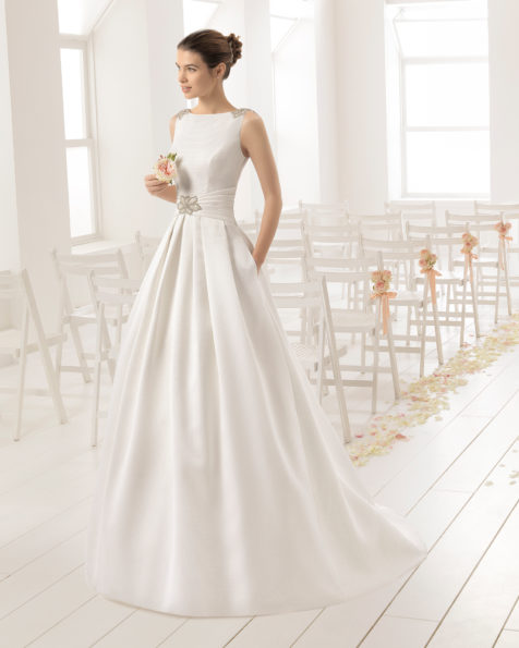 Classic-style tailored piqué wedding dress with bateau neckline and jewelled V-back with frosted beading, in natural.