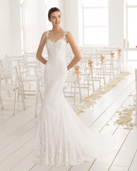 Mermaid-style beaded lace and tulle wedding dress with sweetheart neckline and low back, in natural.
