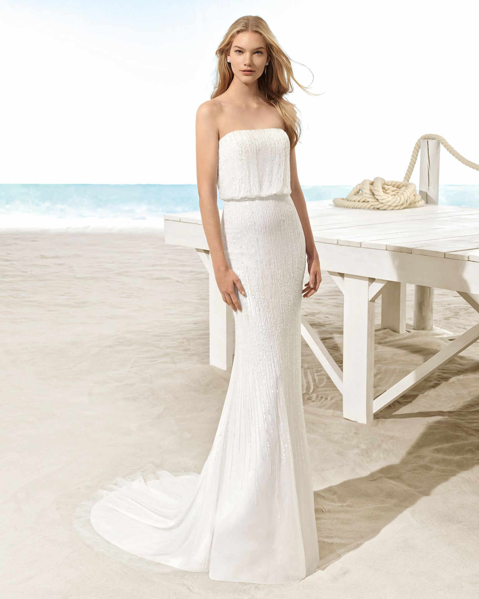 Boho-style beaded strapless wedding dress with bloused bodice.