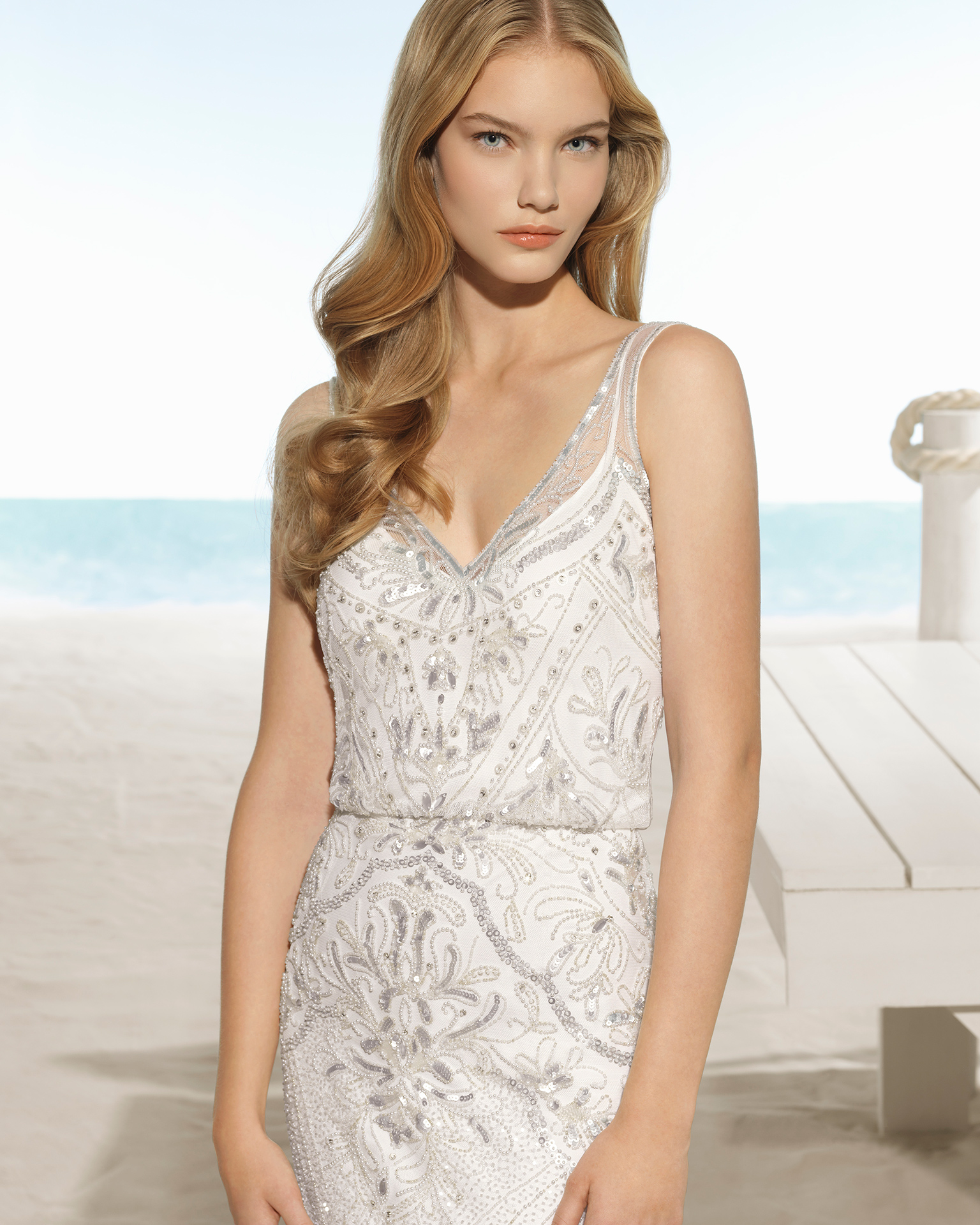 Beaded sheath wedding dress with V-neckline and open back, in natural and natural/silver.