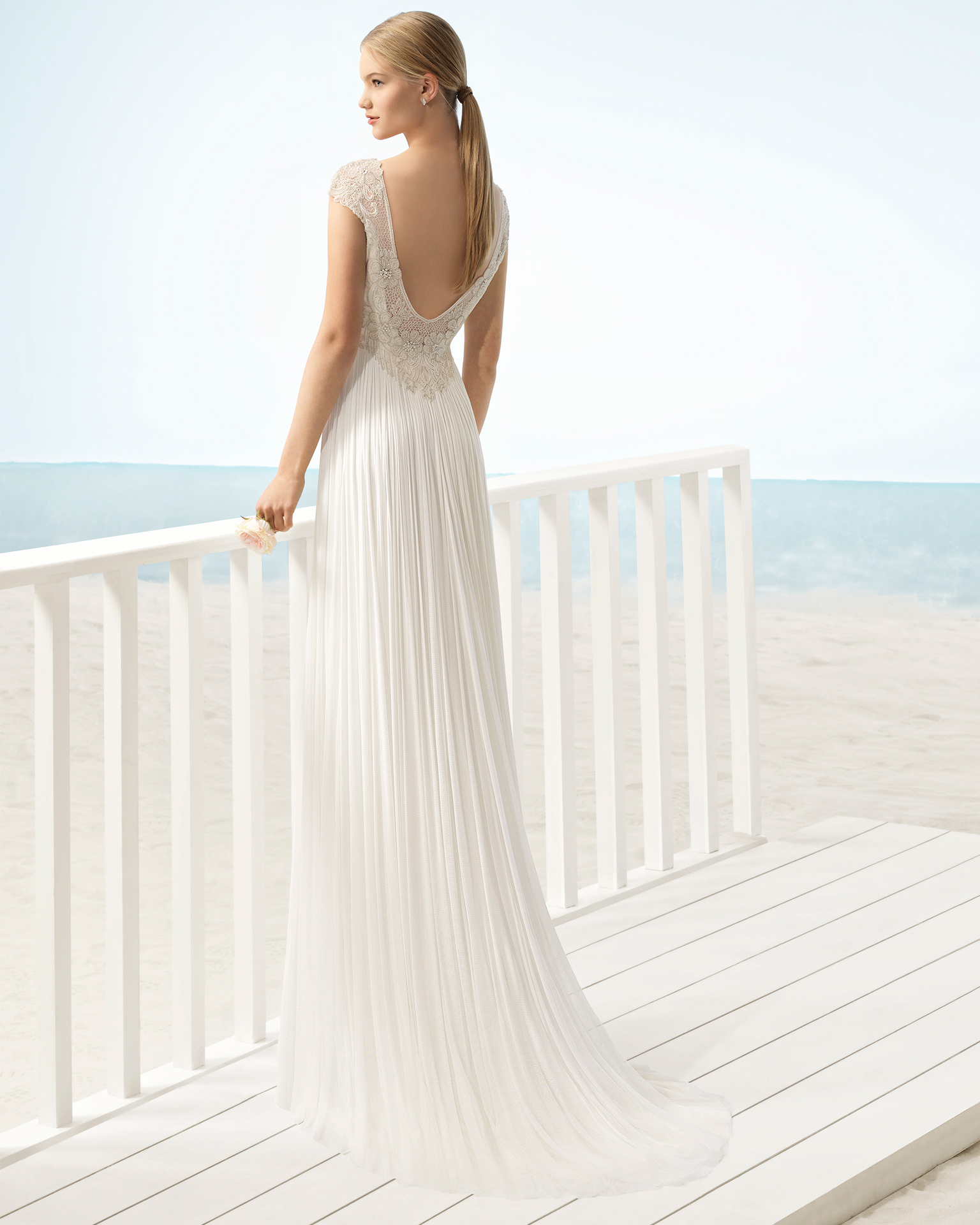 Boho-style silk mousseline wedding dress with bateau neckline and jeweled back.