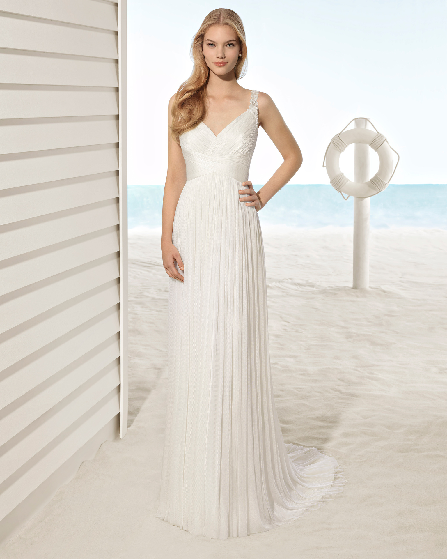 Boho-style silk mousseline wedding dress with crossover neckline and jeweled back.