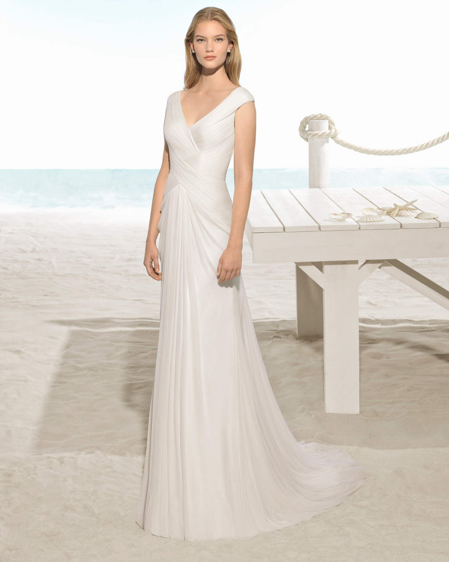 Boho-style silk muslin wedding dress with crossover neckline and back with crossover shoulder straps.