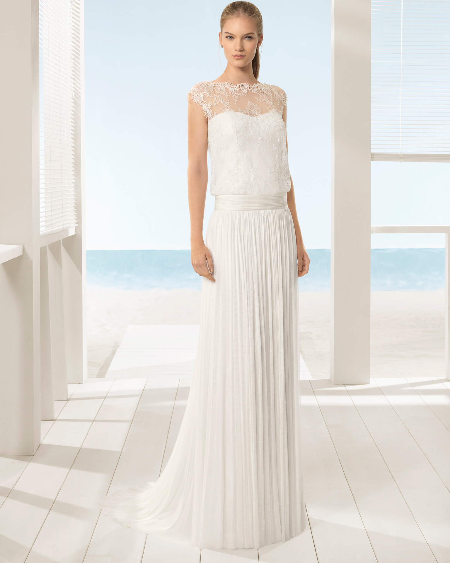 Boho-style beaded lace and silk mousseline wedding dress with bloused bodice and sweetheart neckline with illusion overlay.