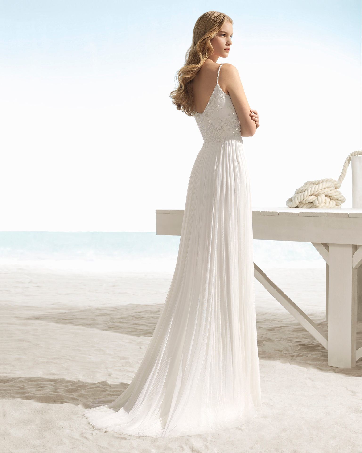 Boho-style beaded lace and silk muslin wedding dress with V-neckline and V-back.