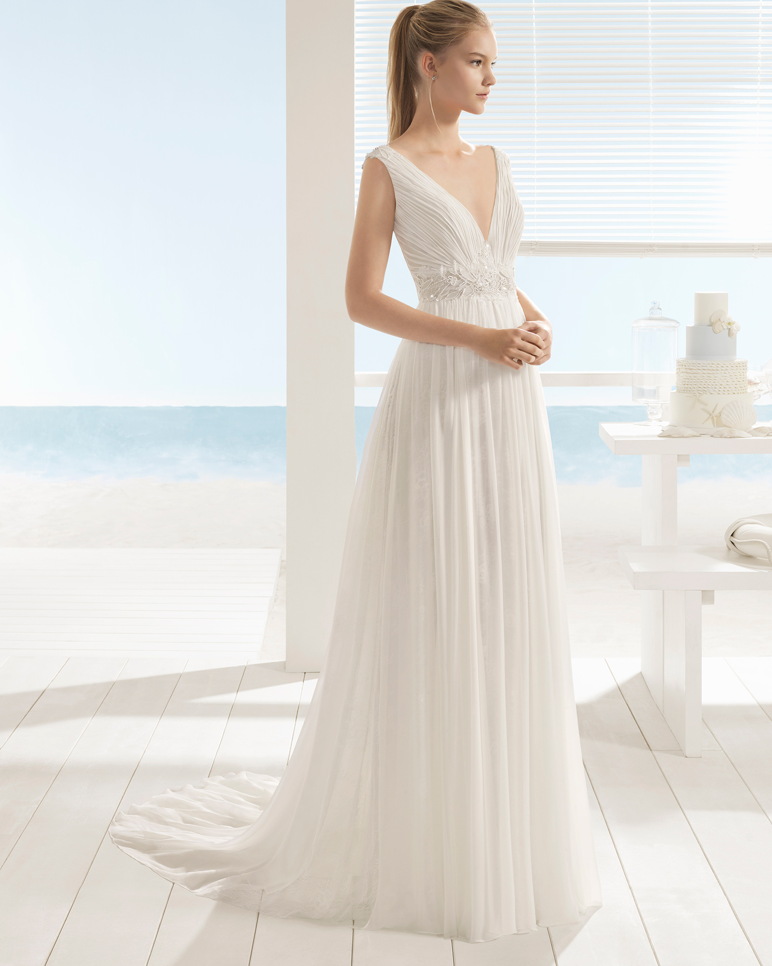 Boho-style silk chiffon wedding dress with V-neckline and low back with beadwork detail.