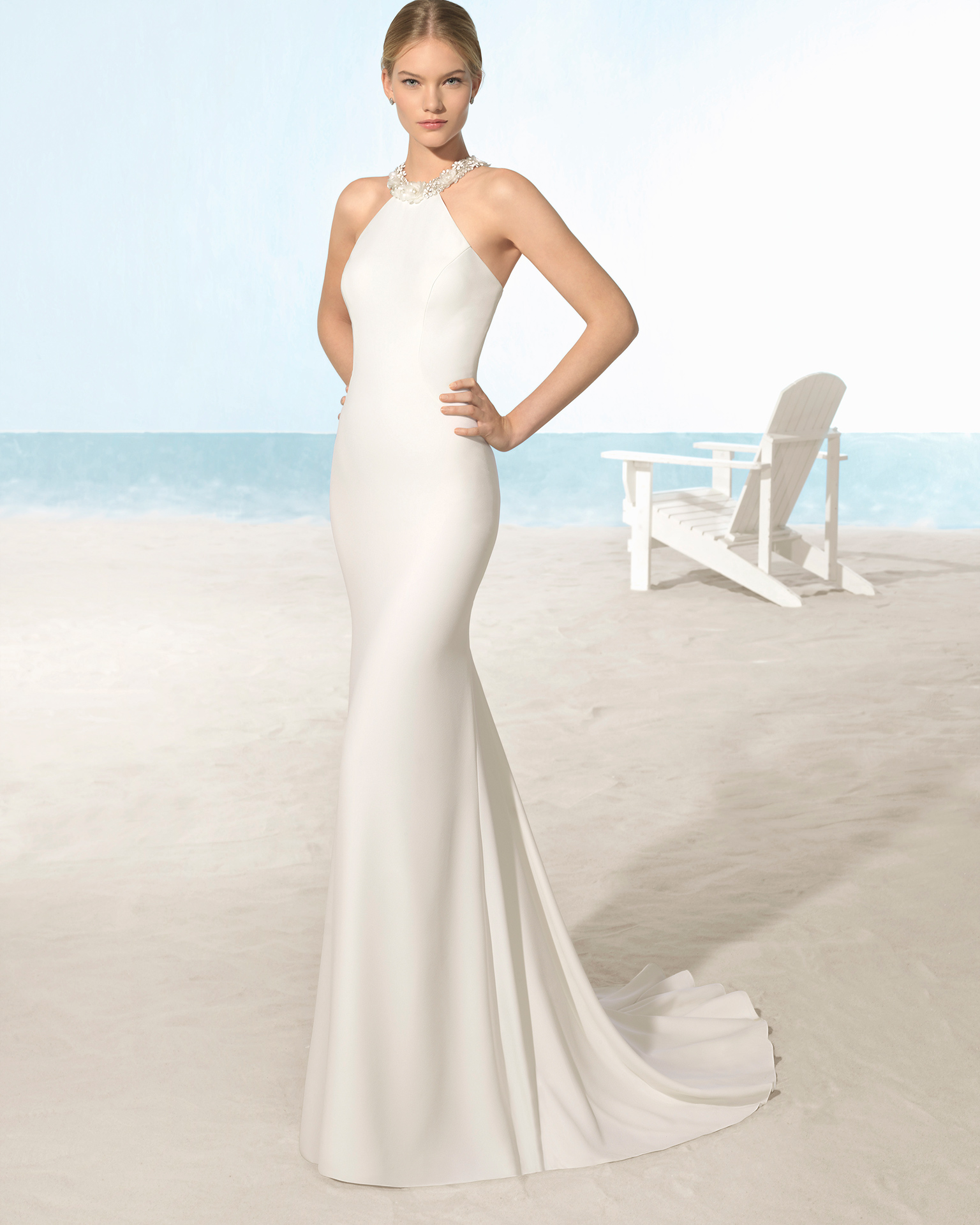 ce02305dd4f Mermaid-style crepe wedding dress with halter neckline
