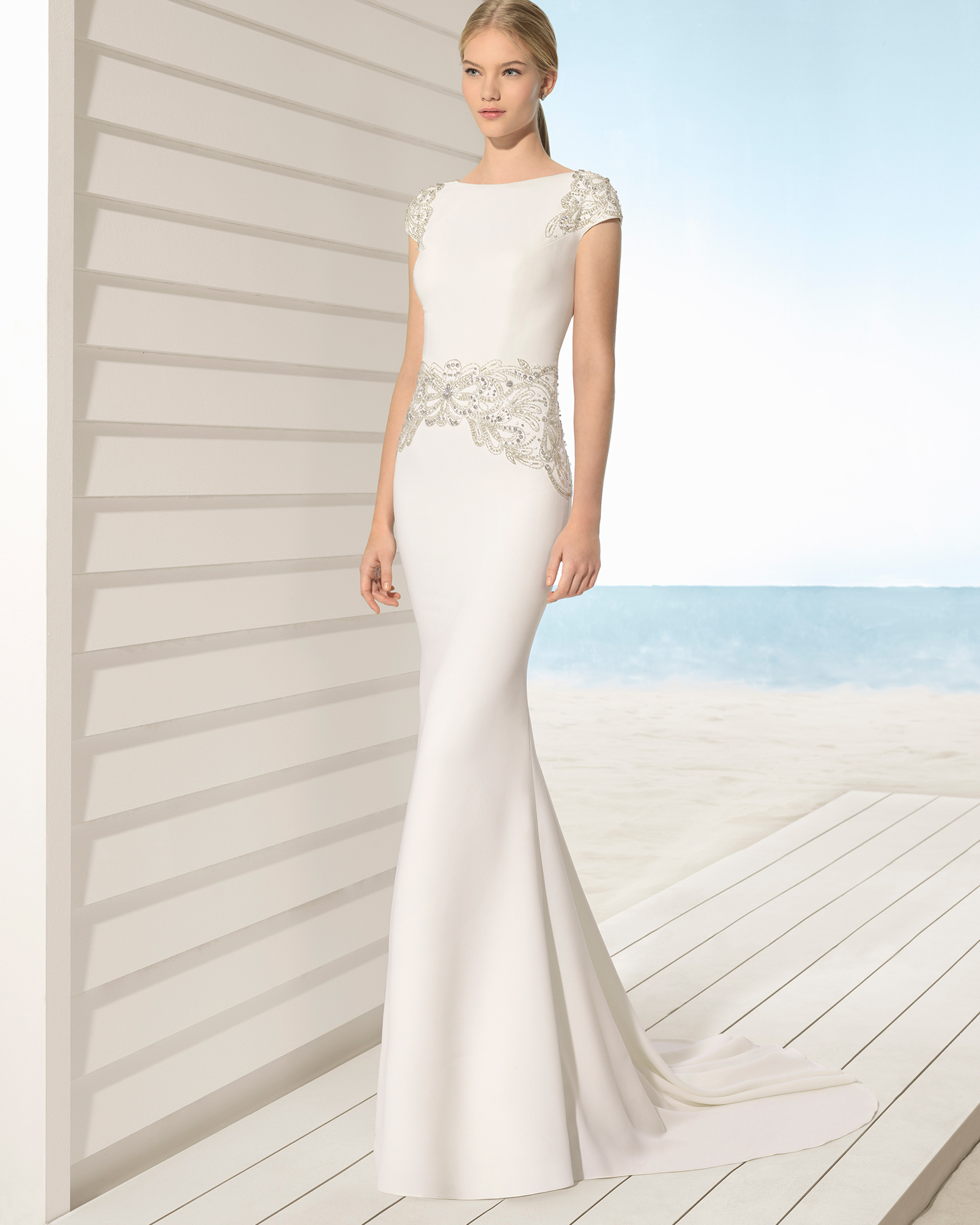 Mermaid-style crepe wedding dress with short sleeves, bateau neckline and low back with beadwork detail, in natural/gold.