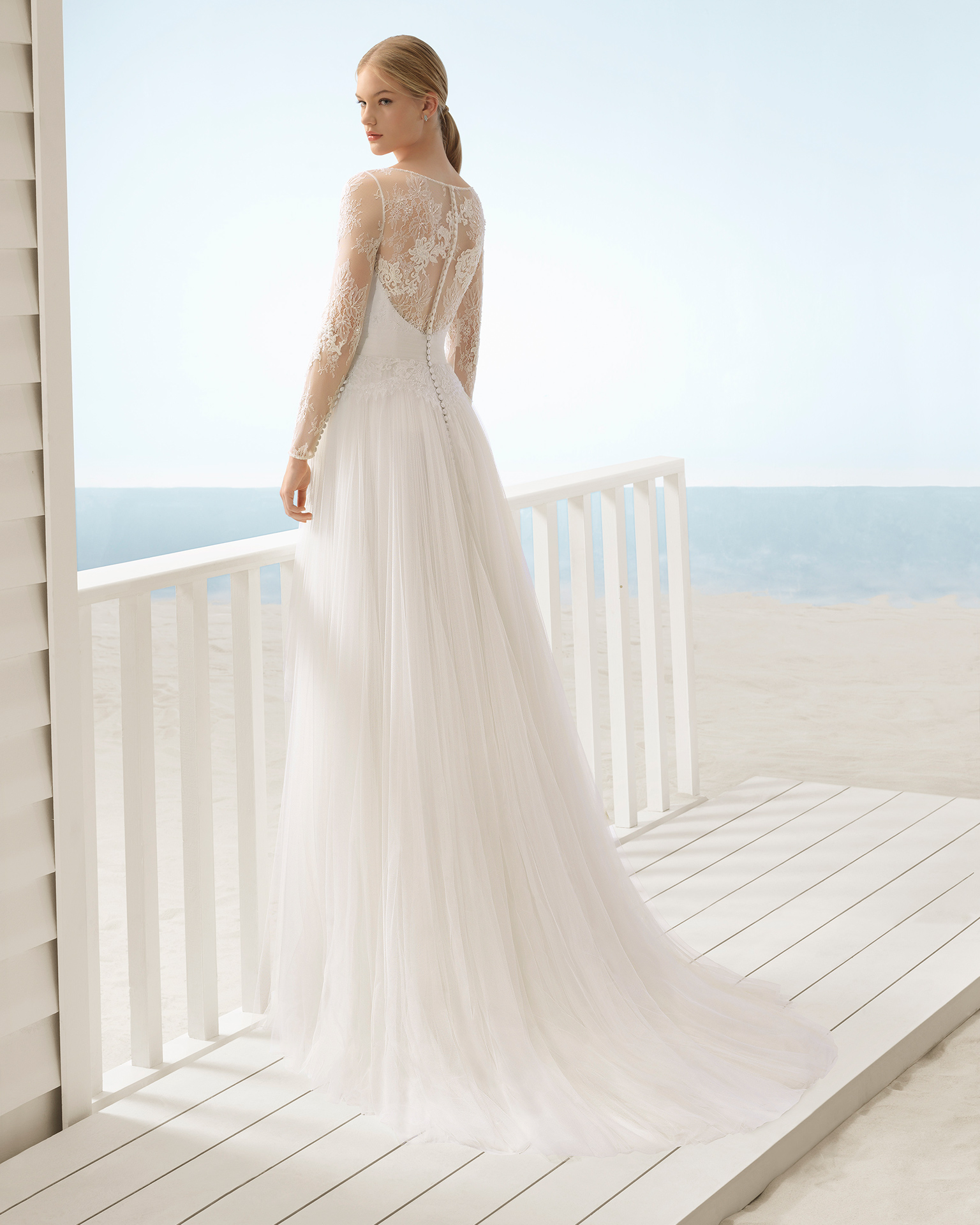 A-line beaded lace and tulle wedding dress with long sleeves, low back with sheer inserts and full skirt.