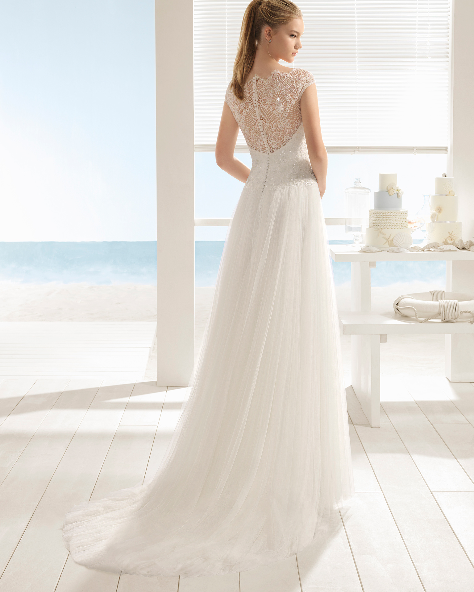 A-line beaded lace and tulle wedding dress with short sleeves and low back.