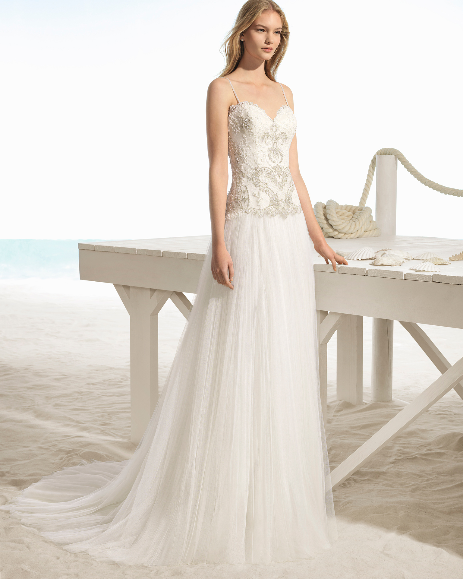 A-line beaded lace and tulle wedding dress with sweetheart neckline, in natural/gold.