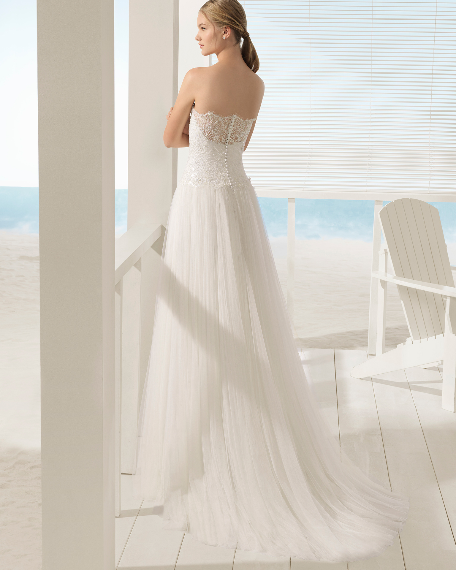 A-line beaded lace and tulle strapless wedding dress with sheer inserts and jacket.