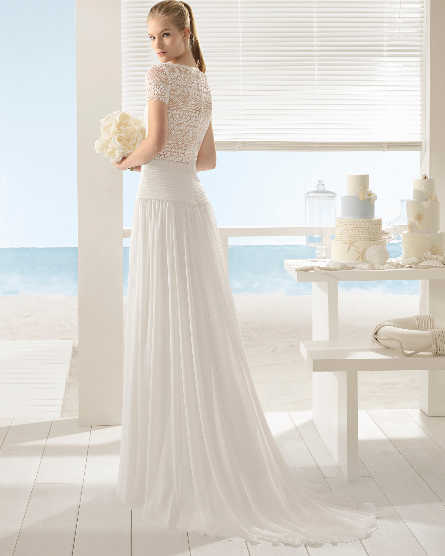 Boho-style three-piece crepe Georgette and lace wedding dress with short sleeves.