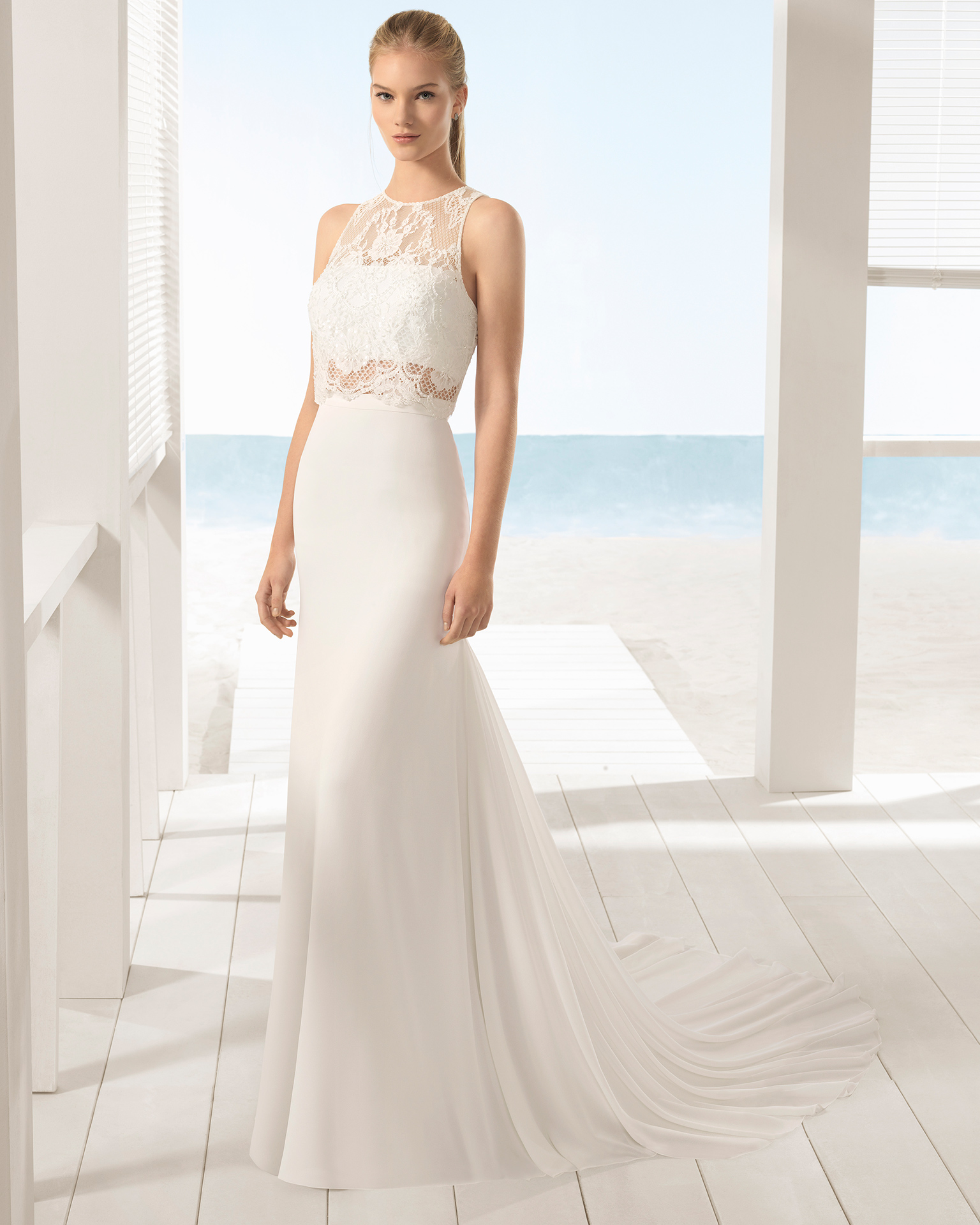 Boho-style beaded lace and crepe Georgette three-piece wedding dress with halter neckline and jacket.