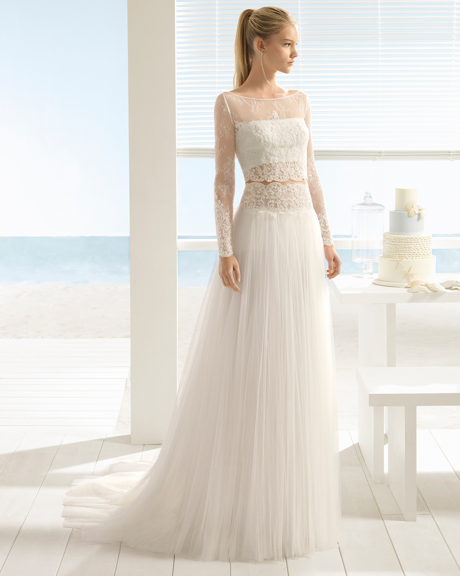 Boho-style beaded lace and soft tulle three-piece wedding dress with long sleeves and jacket.