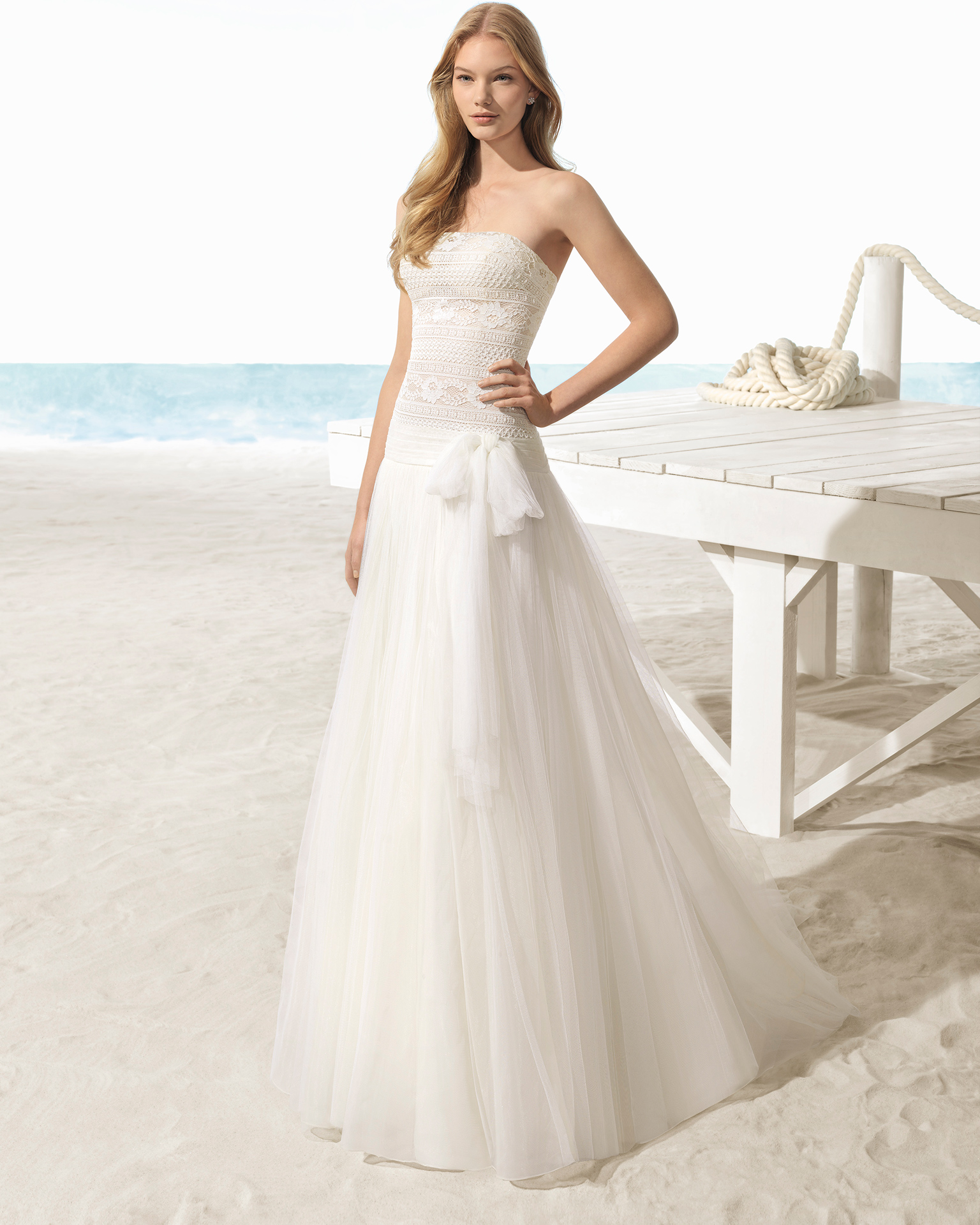 A-line tulle and lace strapless wedding dress, in ivory.