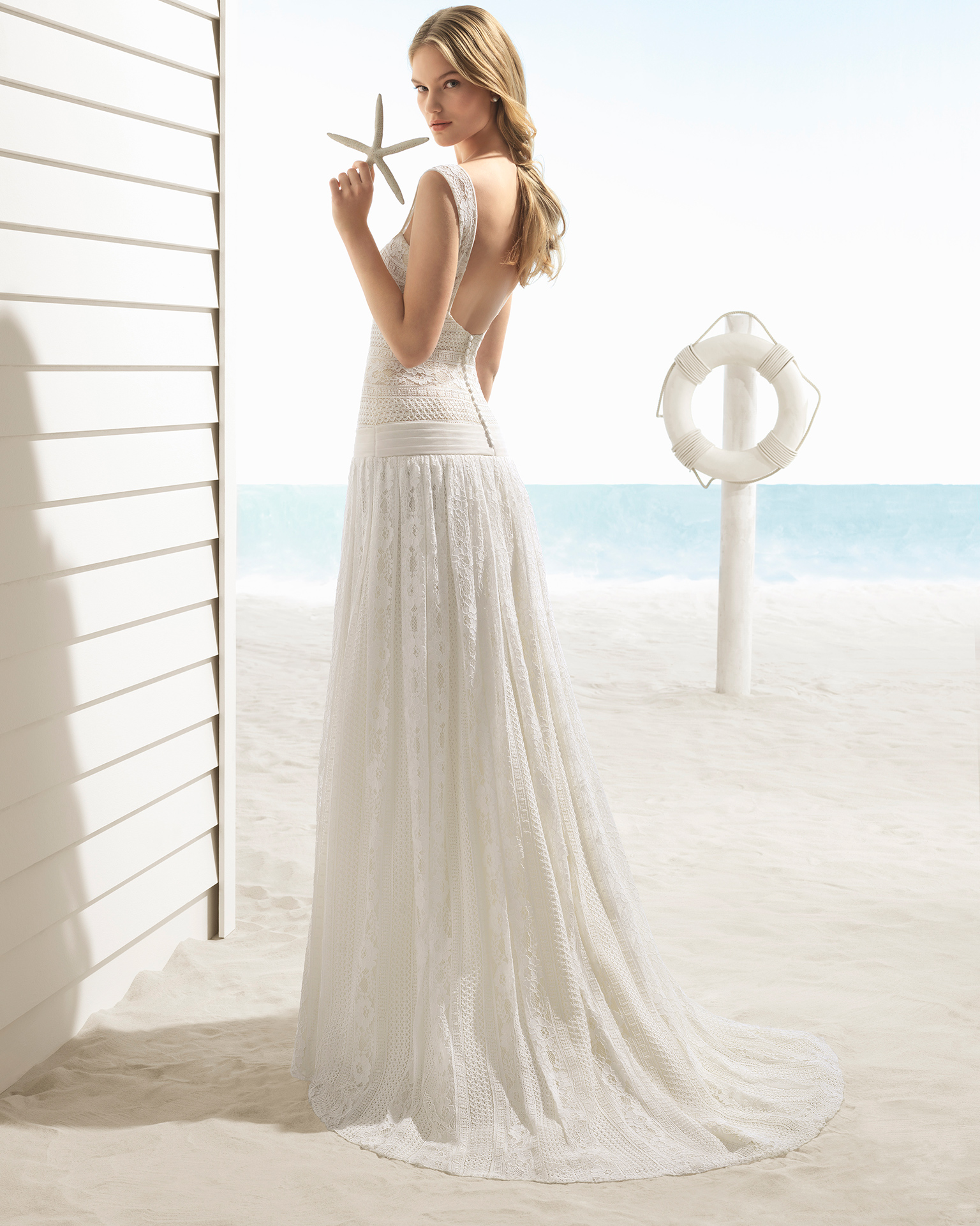 A-line lace wedding dress with low back, in ivory.