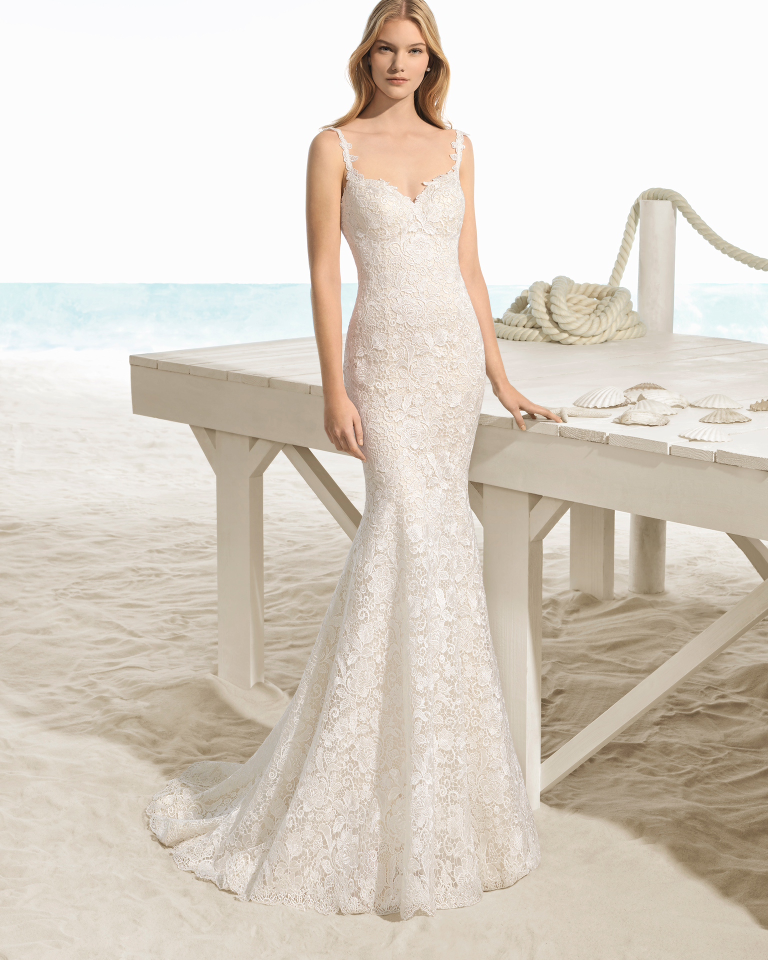 Mermaid-style guipure lace wedding dress with sweetheart neckline and low back, in ivory.