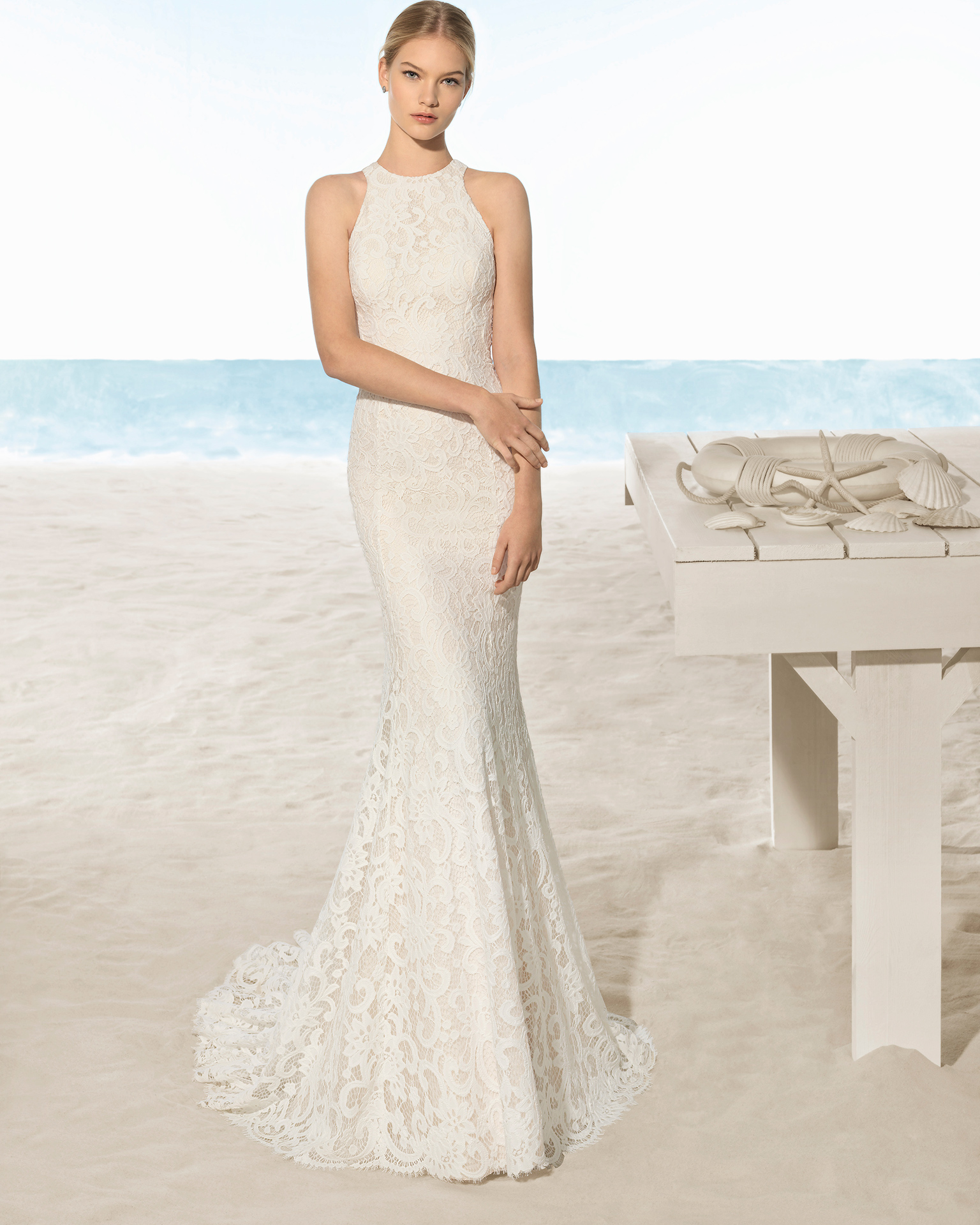 Mermaid-style lace wedding dress with halter neckline and round opening in back, in natural and nude.