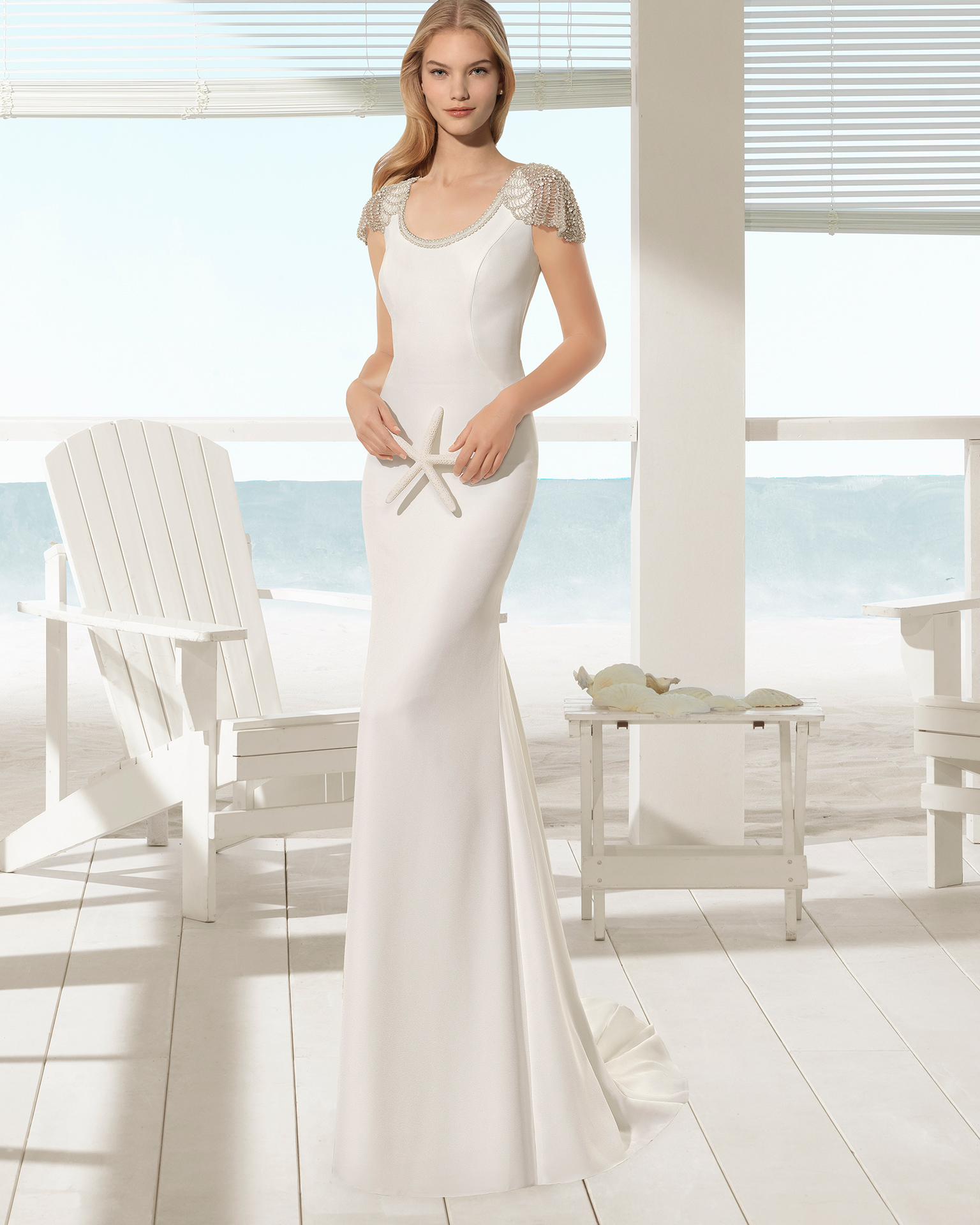 Crepe sheath wedding dress with round neck and jewelled back with frosted beading, in natural.