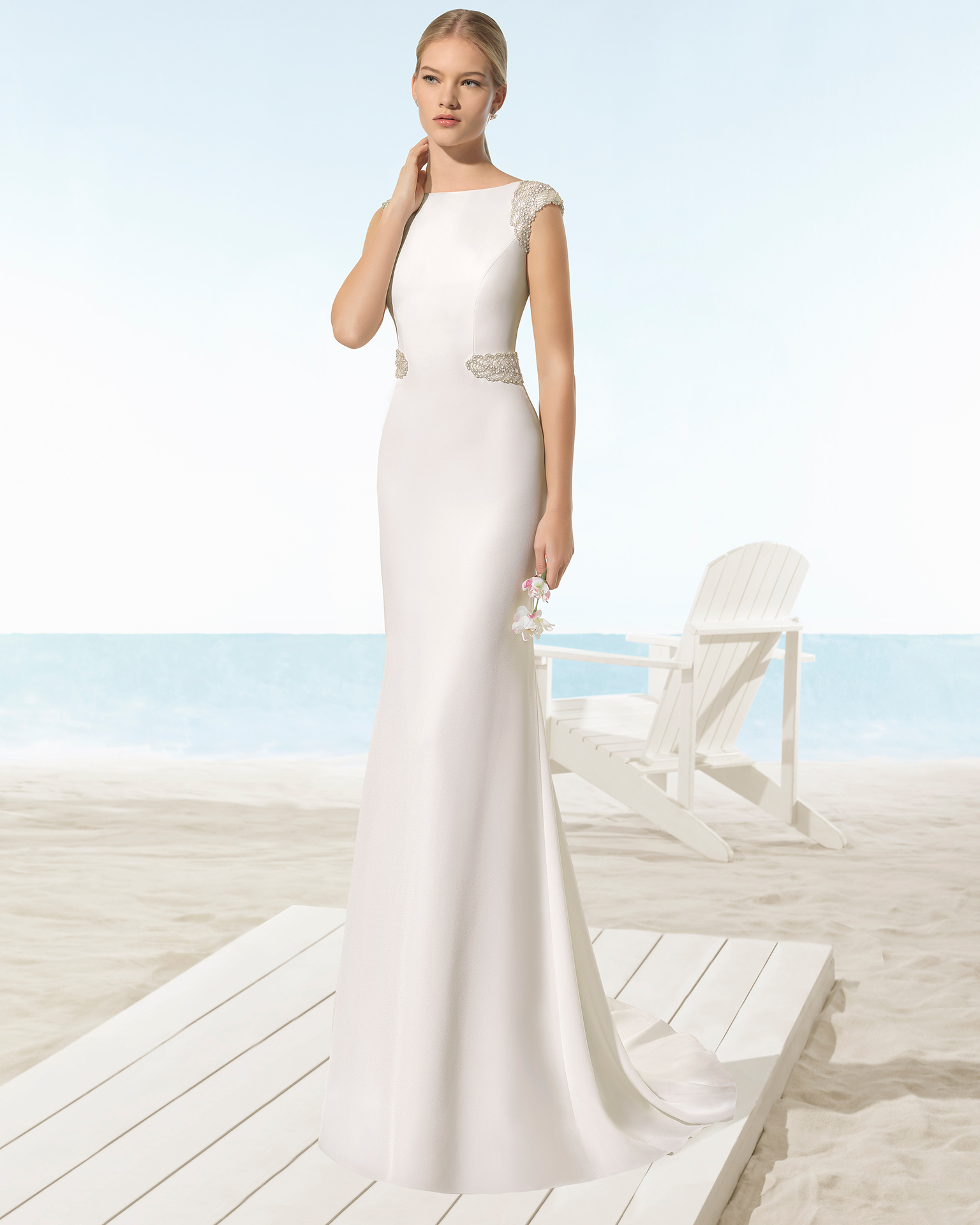 Crepe sheath wedding dress with bateau neckline and jewelled back with frosted beading, in natural.