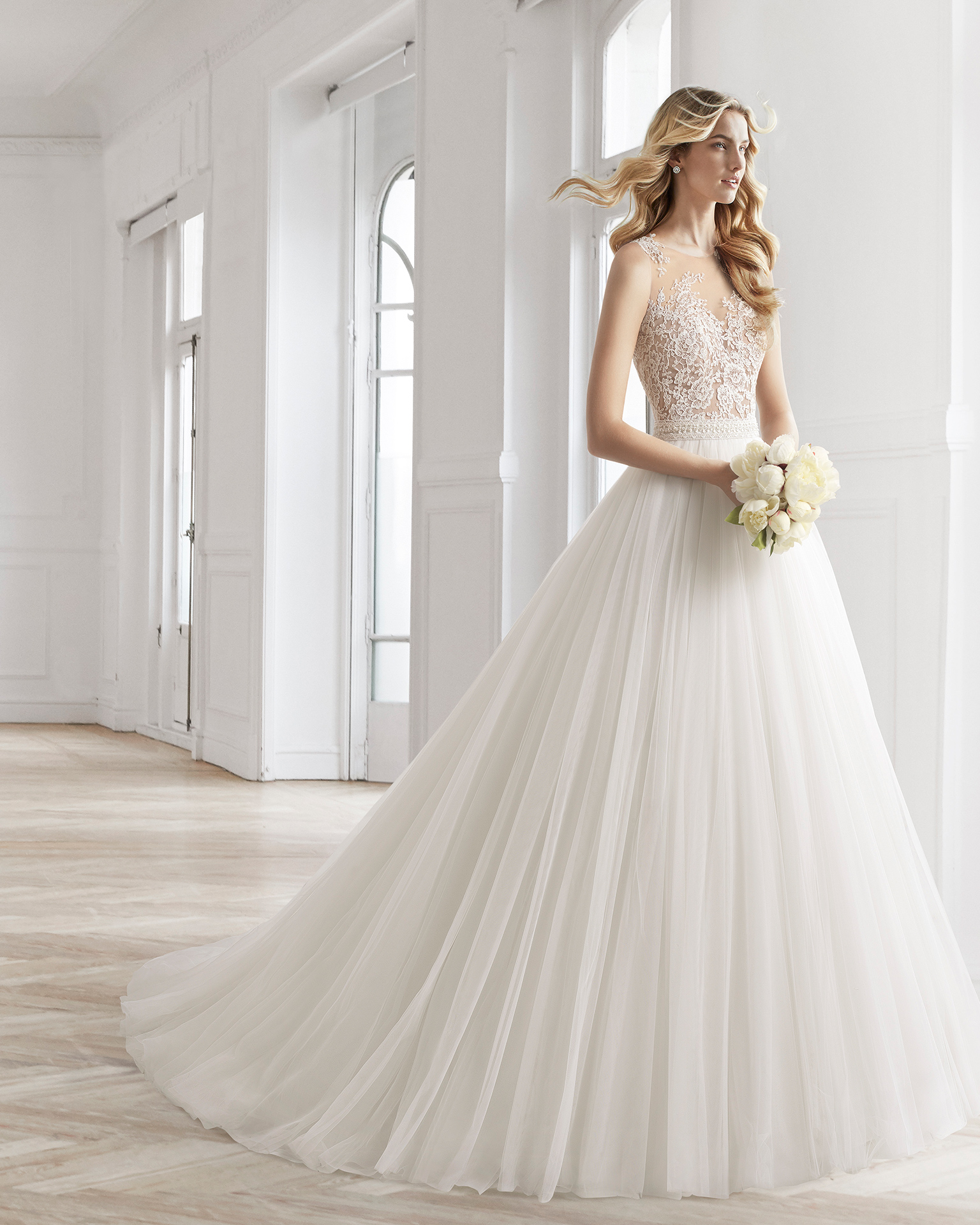 A-line beaded sheer lace and tulle wedding dress.
