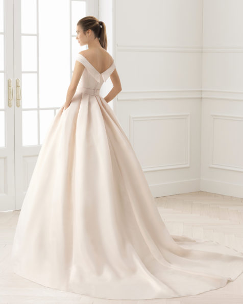 Classic-style tailored gazar wedding dress with bateau neckline and natural waist, in rose and natural.